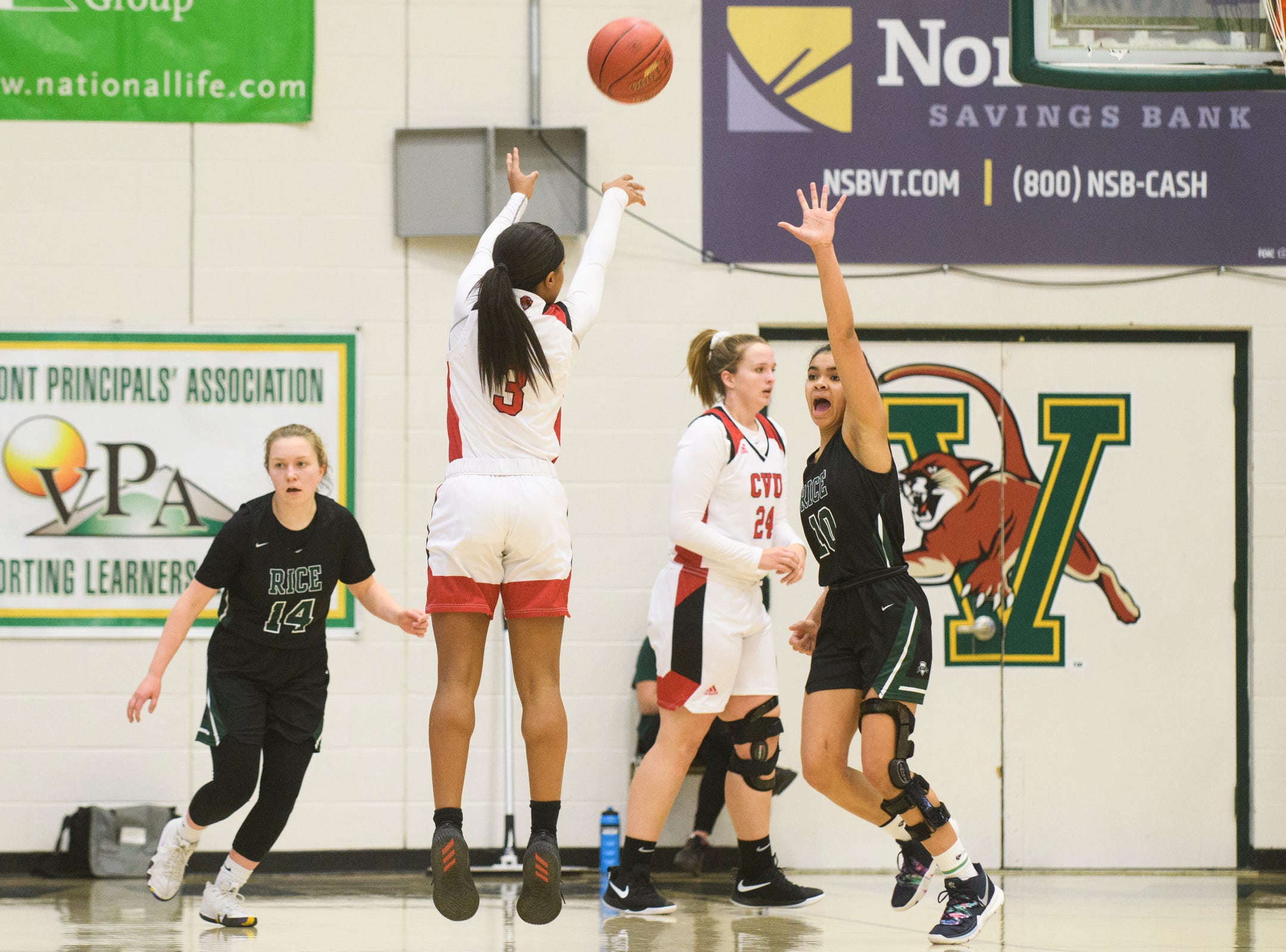 CVU's Mekkena Boyd (3) shoots the ball during the girls semifinal basketball game between the Rice Green Knights and the Champlain Valley Union Redhawks at Patrick Gym on Wednesday nigh March 6, 2019 in Burlington, Vermont.
