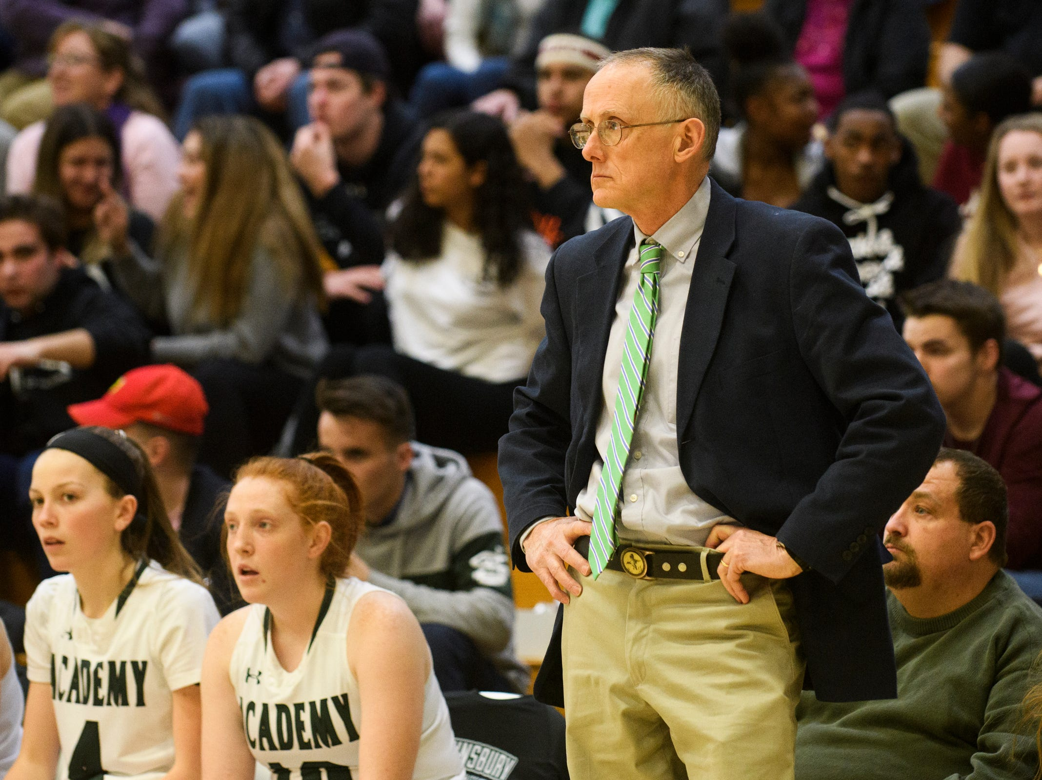 St. Johnsbury head coach Jack Driscoll watches the action on the court during the girls semifinal basketball game between the BFA St. Albans Comets and the St. Johnsbury Hilltoppers at Patrick Gym on Wednesday night March 6, 2019 in Burlington, Vermont.