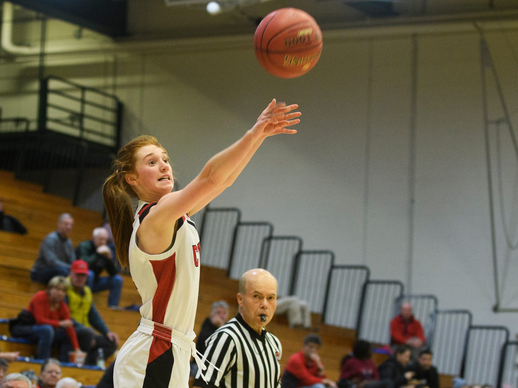 CVU's Catherine Gilwee (4) shoots a three pointer during the girls semifinal basketball game between the Rice Green Knights and the Champlain Valley Union Redhawks at Patrick Gym on Wednesday nigh March 6, 2019 in Burlington, Vermont.