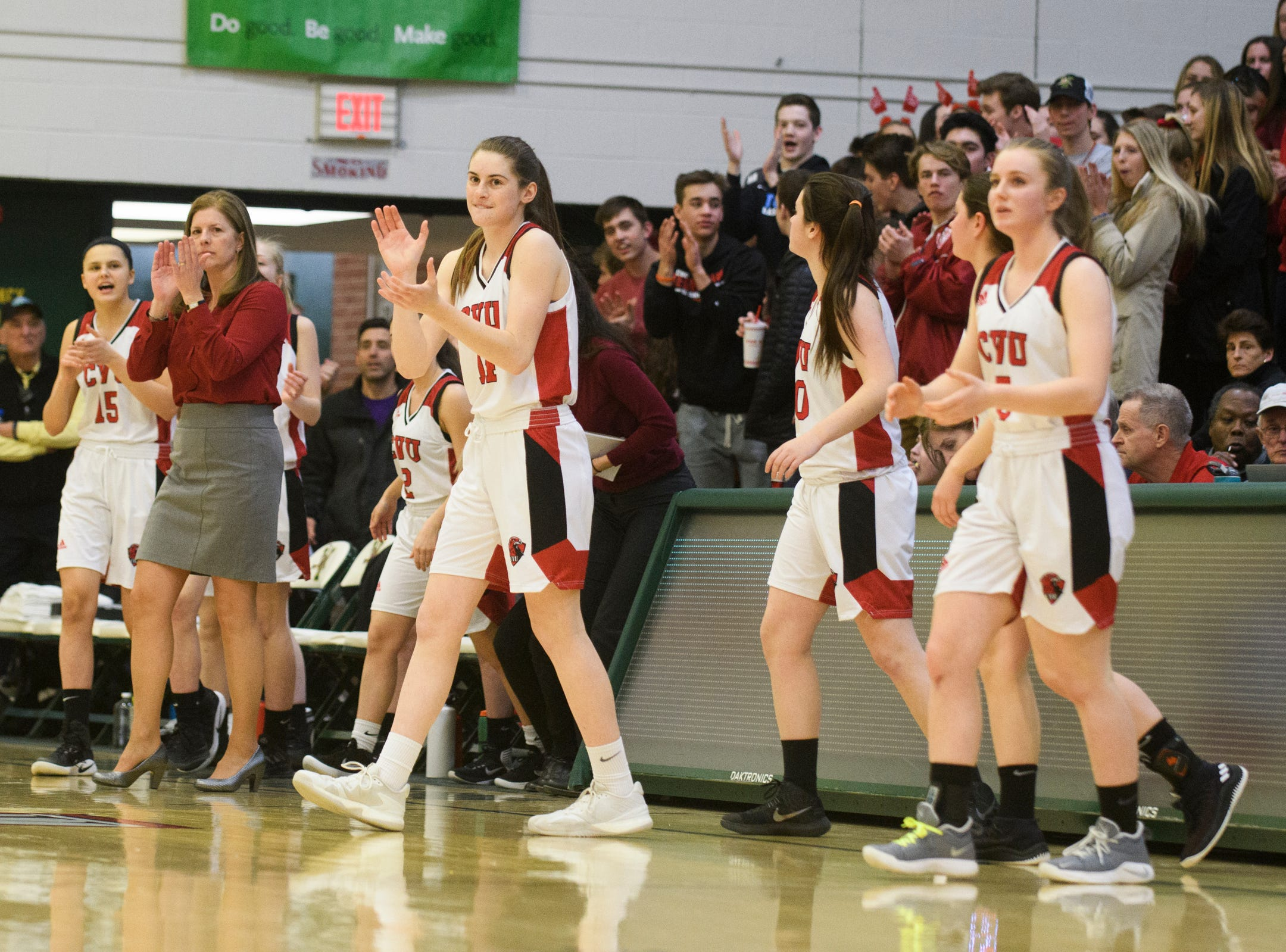 The CVU bench cheers for the team on the court during the girls semifinal basketball game between the Rice Green Knights and the Champlain Valley Union Redhawks at Patrick Gym on Wednesday nigh March 6, 2019 in Burlington, Vermont.