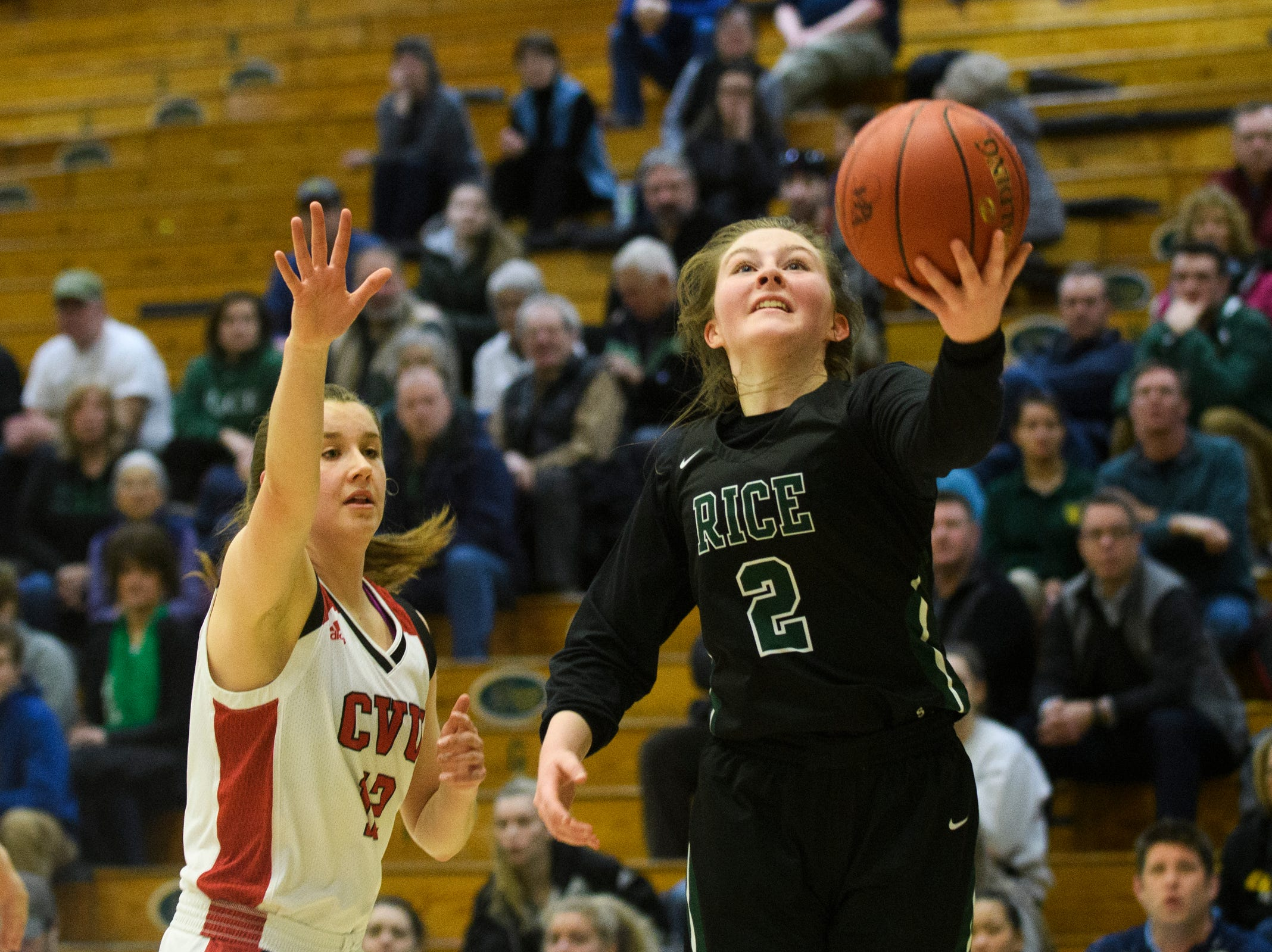 Rice's Fiona Connlooy (2) drives to the hoop during the girls semifinal basketball game between the Rice Green Knights and the Champlain Valley Union Redhawks at Patrick Gym on Wednesday nigh March 6, 2019 in Burlington, Vermont.
