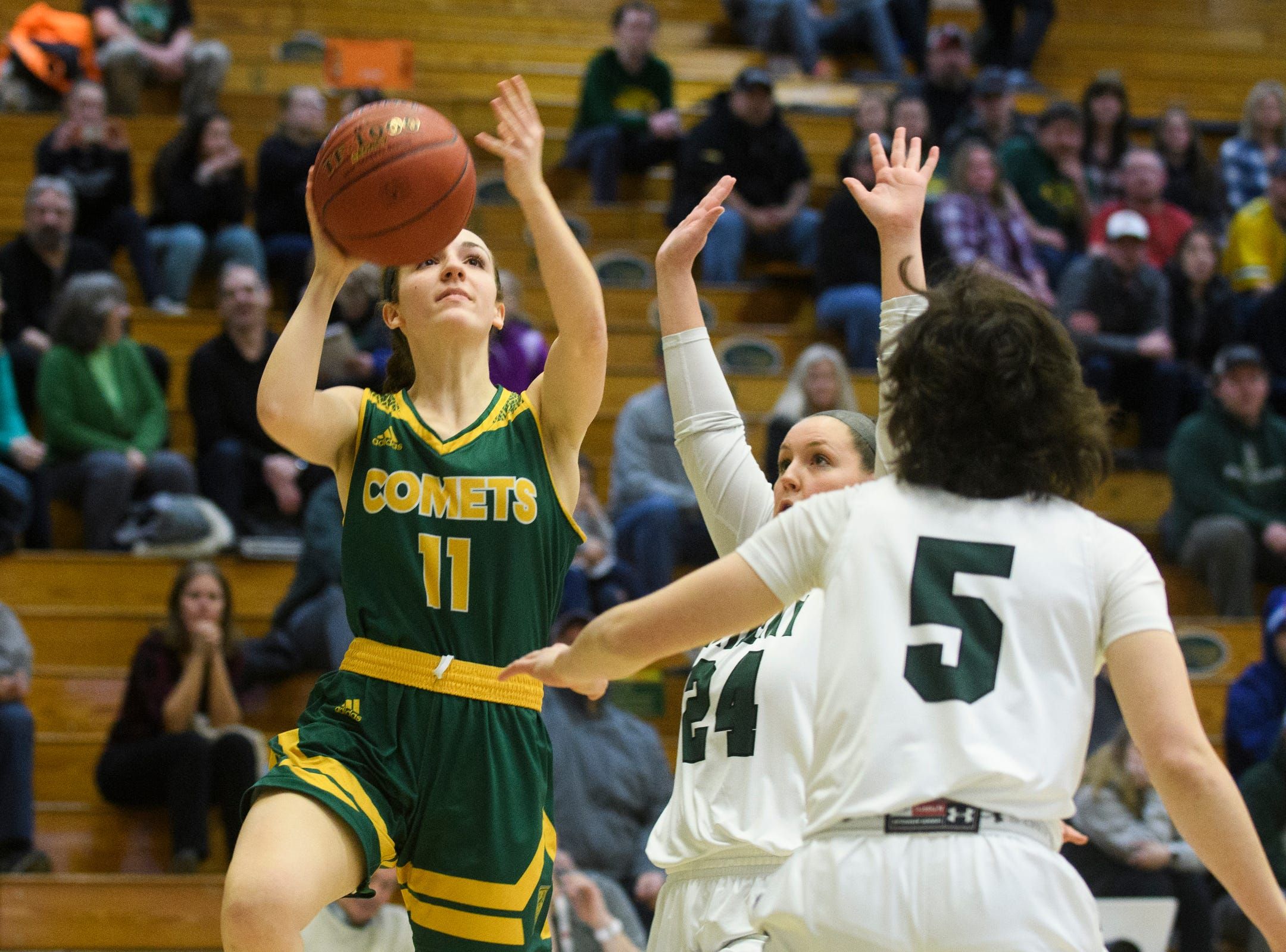 BFA's Elena Clark (11) shoots the ball during the girls semifinal basketball game between the BFA St. Albans Comets and the St. Johnsbury Hilltoppers at Patrick Gym on Wednesday night March 6, 2019 in Burlington, Vermont.