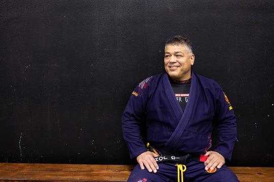 John Barrera watches as a class warms up for a Jiu-Jitsu class at Presa Brazilian Jiu-Jitsu on Wednesday, March 7, 2019. Barrera 57-years-old won double gold at the Pan-American Jiu-Jitsu Championship in 2018.