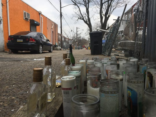 A memorial marks the scene of the Feb. 15 slaying of Julio Sanchez-Moncada in an alley off Merriel Avenue in East Camden.