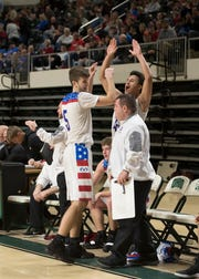 Zane Trace junior Nick Nesser celebrates with fellow teammates as the Pioneers defeat the Athens Bulldogs 48-28 in a Division II district semifinal game at Ohio University's Convocation center on Feb. 28, 2019.