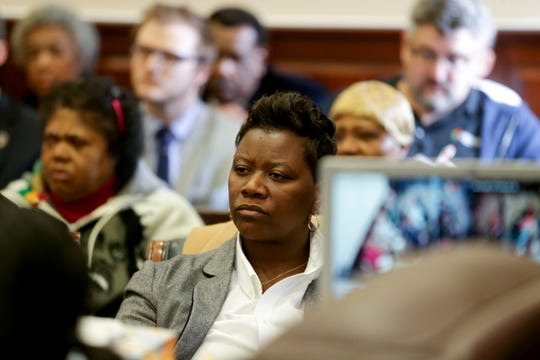 Cincinnati City Council member Tamaya Dennard listens to proceedings during a hearing for a proposed settlement in the lawsuit involving secret texts and email by members of Cincinnati City Council, Thursday, March 7, 2019, at the Hamilton County Courthouse in Cincinnati.