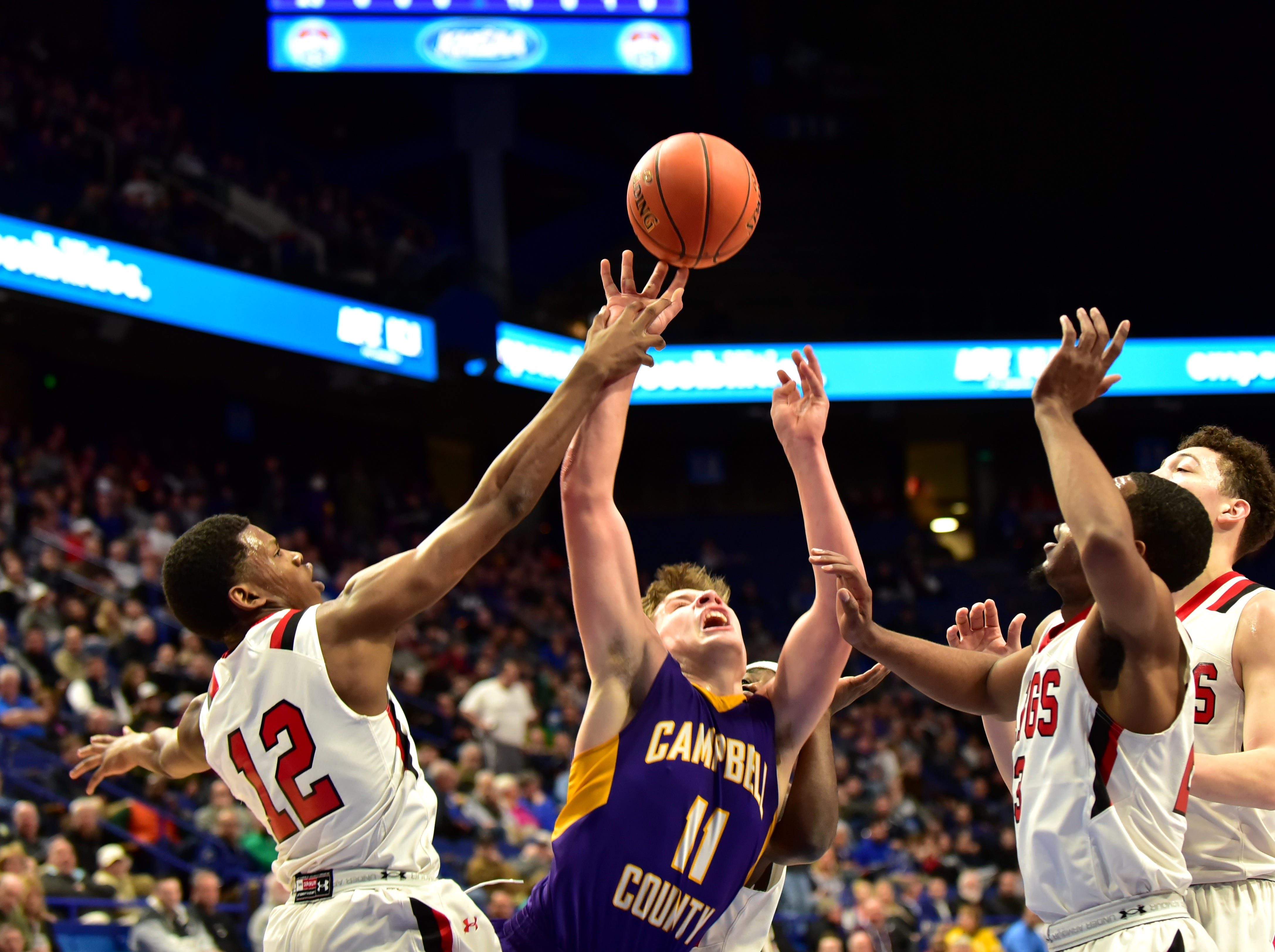 Reid Jolly (11) of Campbell County is fouled hard by the defense at the KHSAA Sweet 16 Tournament at Rupp Arena in Lexington, KY, March 6, 2019