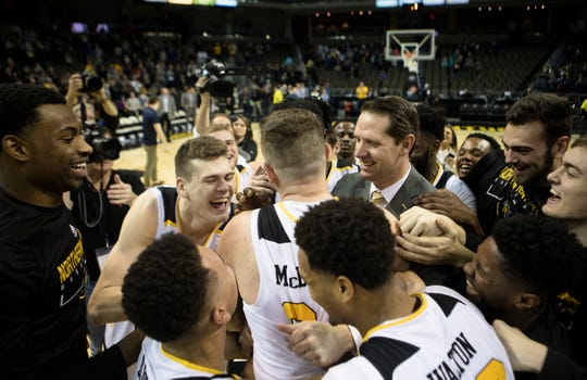 Northern Kentucky Norse head coach John Brannen embraces Northern Kentucky Norse forward Drew McDonald (34) with the rest of the team after the NCAA men's basketball game between Northern Kentucky Norse and Detroit Titans on Wednesday, March 6, 2019, at BB&T Arena in Highland Heights, Ky. McDonald became the all time leading scorer for the Northern Kentucky men's basketball the previous game and added to his record during the game. Northern Kentucky Norse defeated Detroit Titans 99-88.