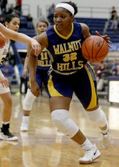 Walnut Hills forward Zuri Williams moves the ball against Centerville during their Division I regional semifinal basketball game at Trent Arena in Kettering Wednesday, March 6, 2019.