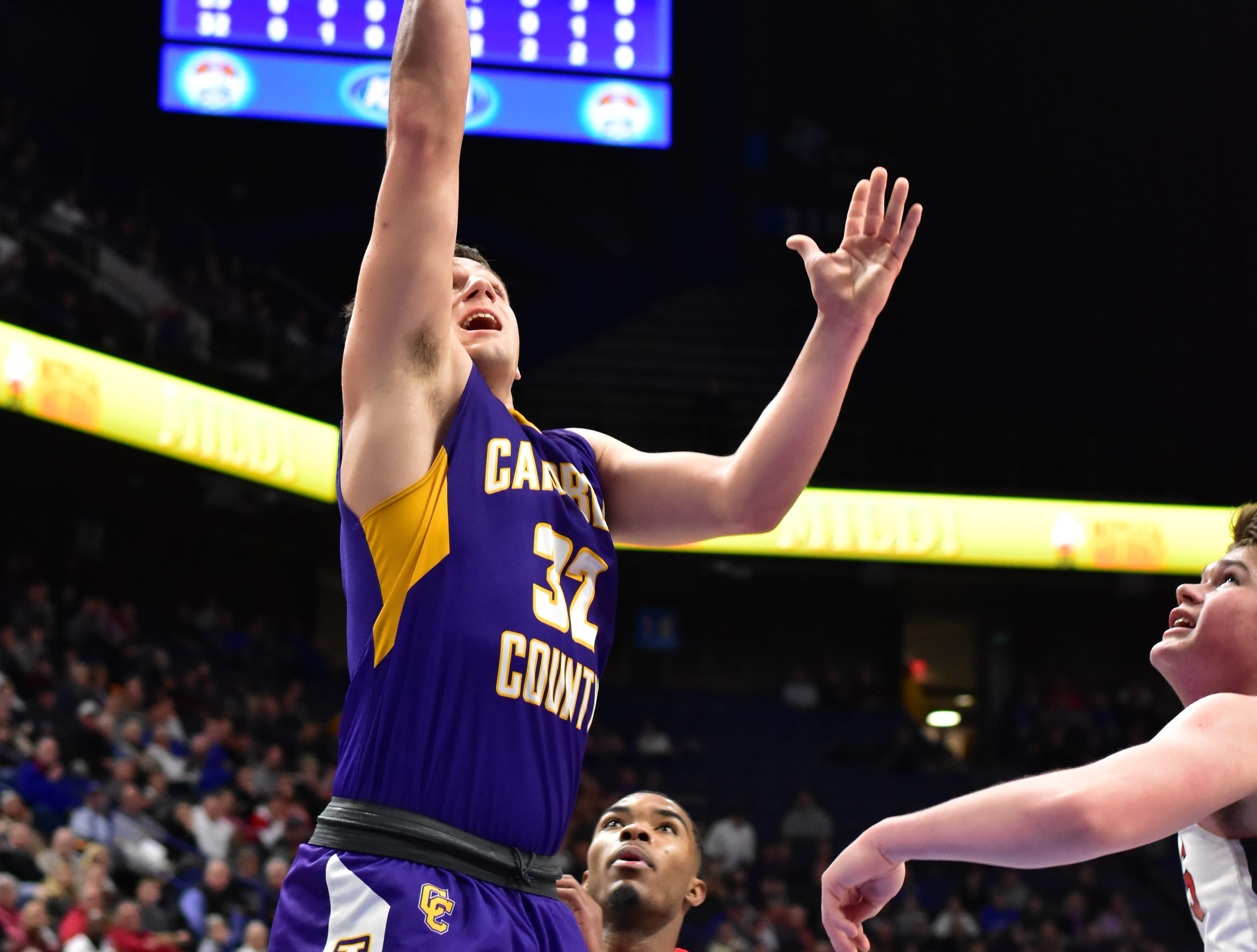 Tanner Lawrence lifts back an offensive rebound for points for Campbell County at the KHSAA Sweet 16 Tournament at Rupp Arena in Lexington, KY, March 6, 2019