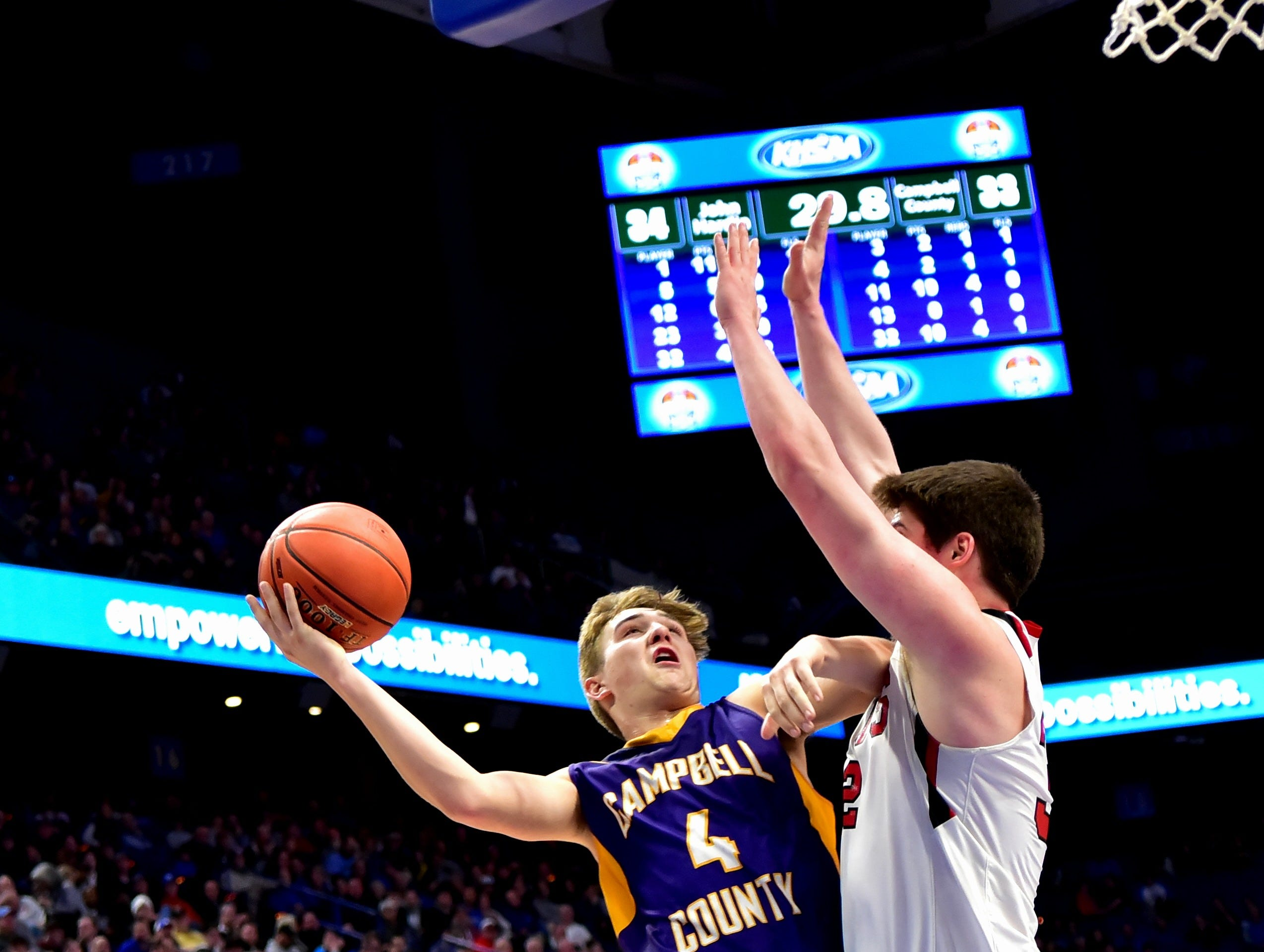 """Drew Wilson (4) of Campbell County collects an """"And One"""" on his way to the hoop for the Camels in their 61-60 win in first round action at the KHSAA Sweet 16 Tournament at Rupp Arena in Lexington, KY, March 6, 2019"""
