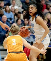 Mount Notre Dame's Laila Phelia is covered by Mercy McAuley's Lexi Fleming during their Division I regional semifinal basketball game at Trent Arena in Kettering Wednesday, Mar. 6, 2019.