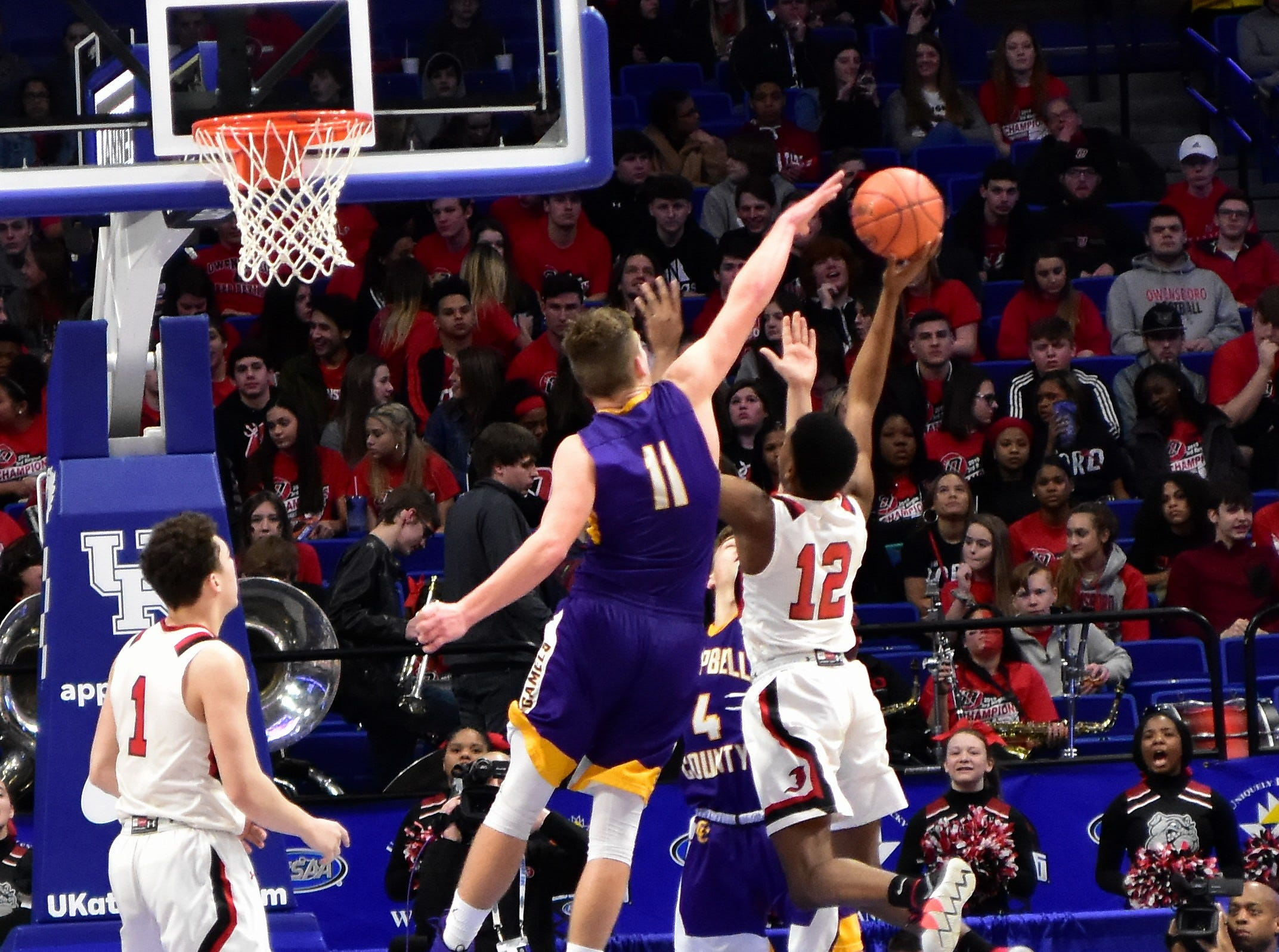Campbell County's Reid Jolly rises to reject a a lay up from John Hardin at the KHSAA Sweet 16 Tournament at Rupp Arena in Lexington, KY, March 6, 2019
