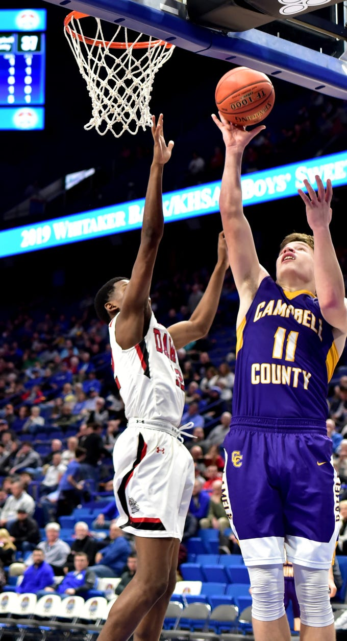 Reid Jolly (11) adds a soft layup to the point count for Campbell County at the KHSAA Sweet 16 Tournament at Rupp Arena in Lexington, KY, March 6, 2019
