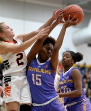 Purcell Marian forward Sha' Dai Hale battles Amanda Clearcreek guard Kilynn Guiler for a rebound    during their regional semifinal Wednesday, March 6, 2019.