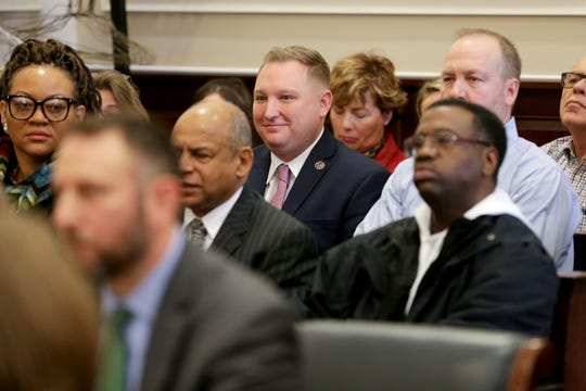 Cincinnati City council members Chris Seelbach, center, reacts to comments by Judge Robert Ruehlman during a hearing for a proposed settlement in the lawsuit involving secret texts and email, Thursday, March 7, 2019, at the Hamilton County Courthouse in Cincinnati.