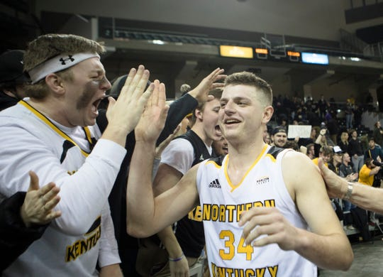 Northern Kentucky Norse forward Drew McDonald (34) celebrates with fan after the NCAA men's basketball game between Northern Kentucky Norse and Detroit Titans on Wednesday, March 6, 2019, at BB&T Arena in Highland Heights, Ky. Northern Kentucky Norse defeated Detroit Titans 99-88.