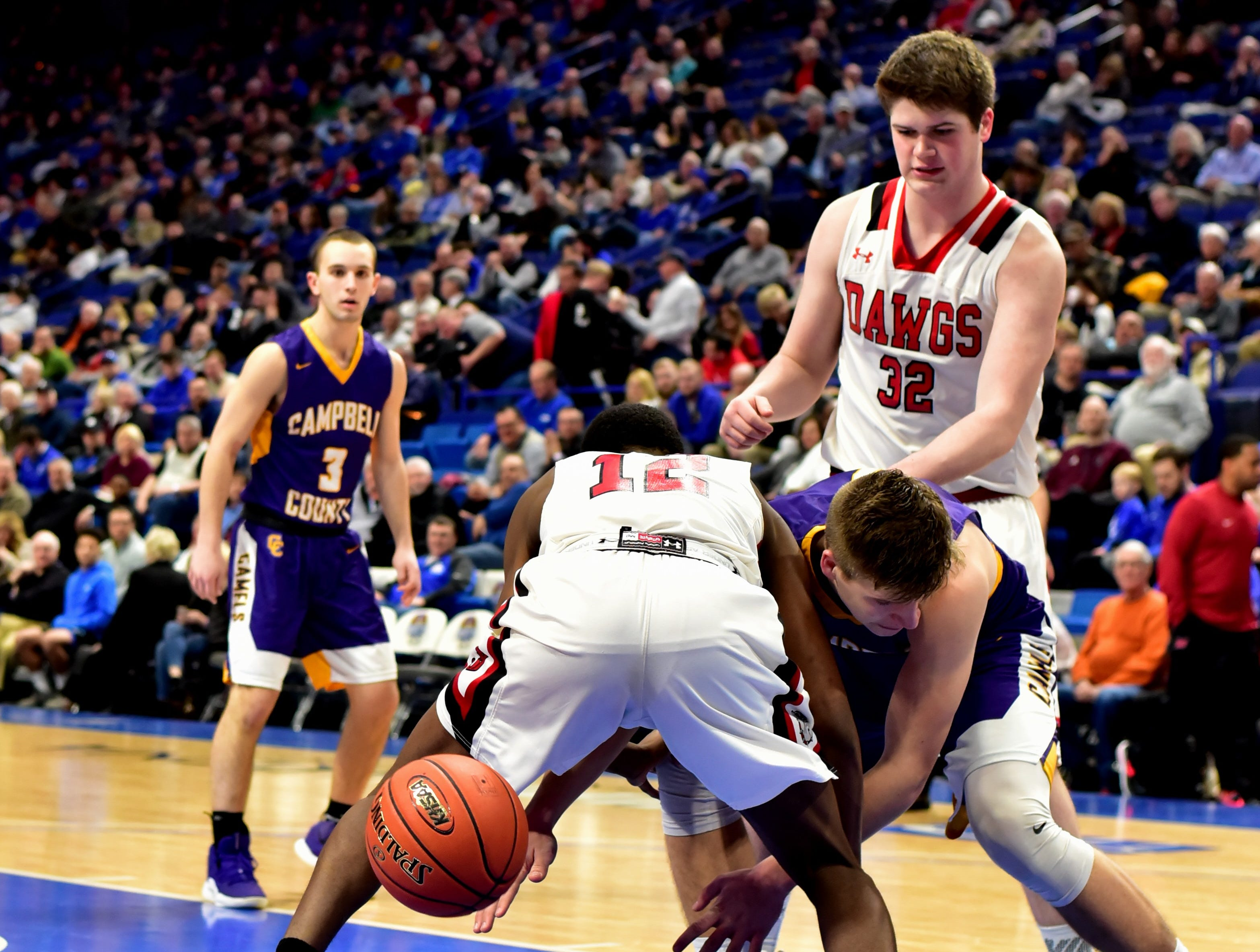 John Hardin and Campbell County find themselves in a fight for possession of the ball late in the game at the KHSAA Sweet 16 Tournament at Rupp Arena in Lexington, KY, March 6, 2019