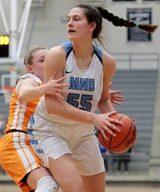 Mount Notre Dame's Julia Hoefling is covered by Mercy McAuley's Lexi Fleming during their Division I regional semifinal basketball game at Trent Arena in Kettering Wednesday, March 6, 2019.