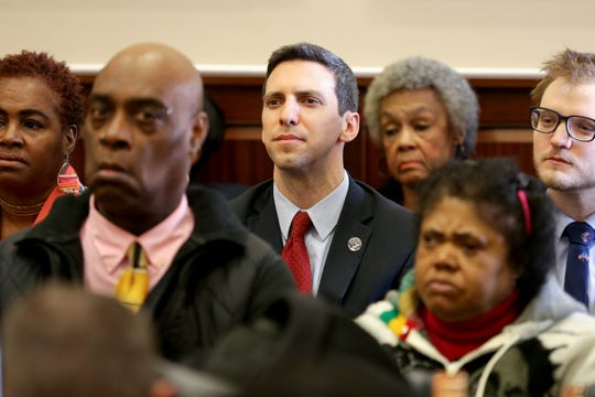 Cincinnati City Council member P.G. Sittenfeld listens to proceedings during a hearing for a proposed settlement in the lawsuit involving secret texts and email by members of Cincinnati City Council, Thursday, March 7, 2019, at the Hamilton County Courthouse in Cincinnati.