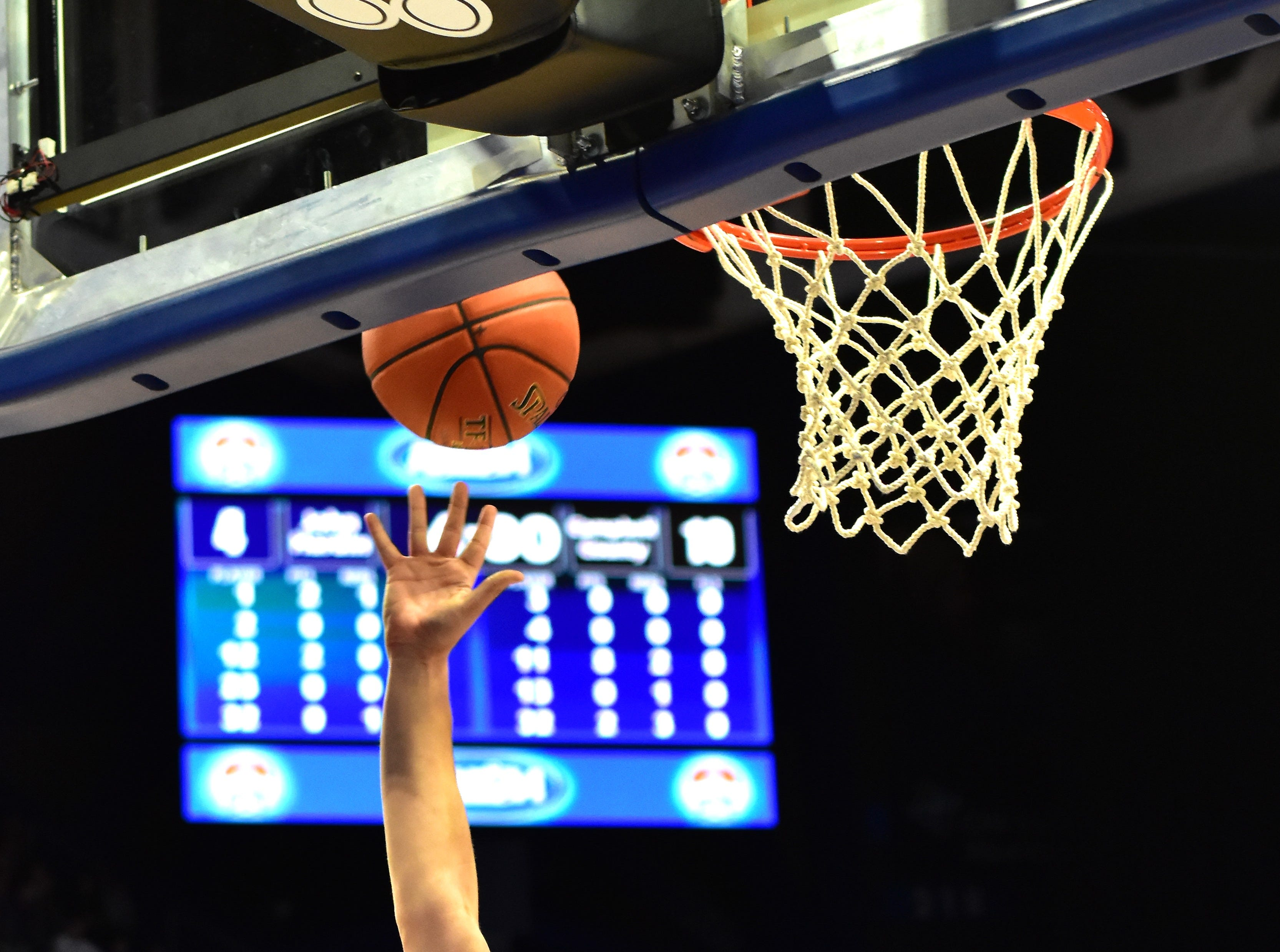 Drew Wilson (4) lays up a shot off of the back board for Campbell County at the KHSAA Sweet 16 Tournament at Rupp Arena in Lexington, KY, March 6, 2019