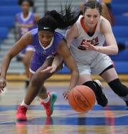 Purcell Marian guard Amil Ali-Shakir  (5) battles Alyssa Evans for a loose ball  during their regional semifinal  basketball game Wednesday, March 6, 2019.