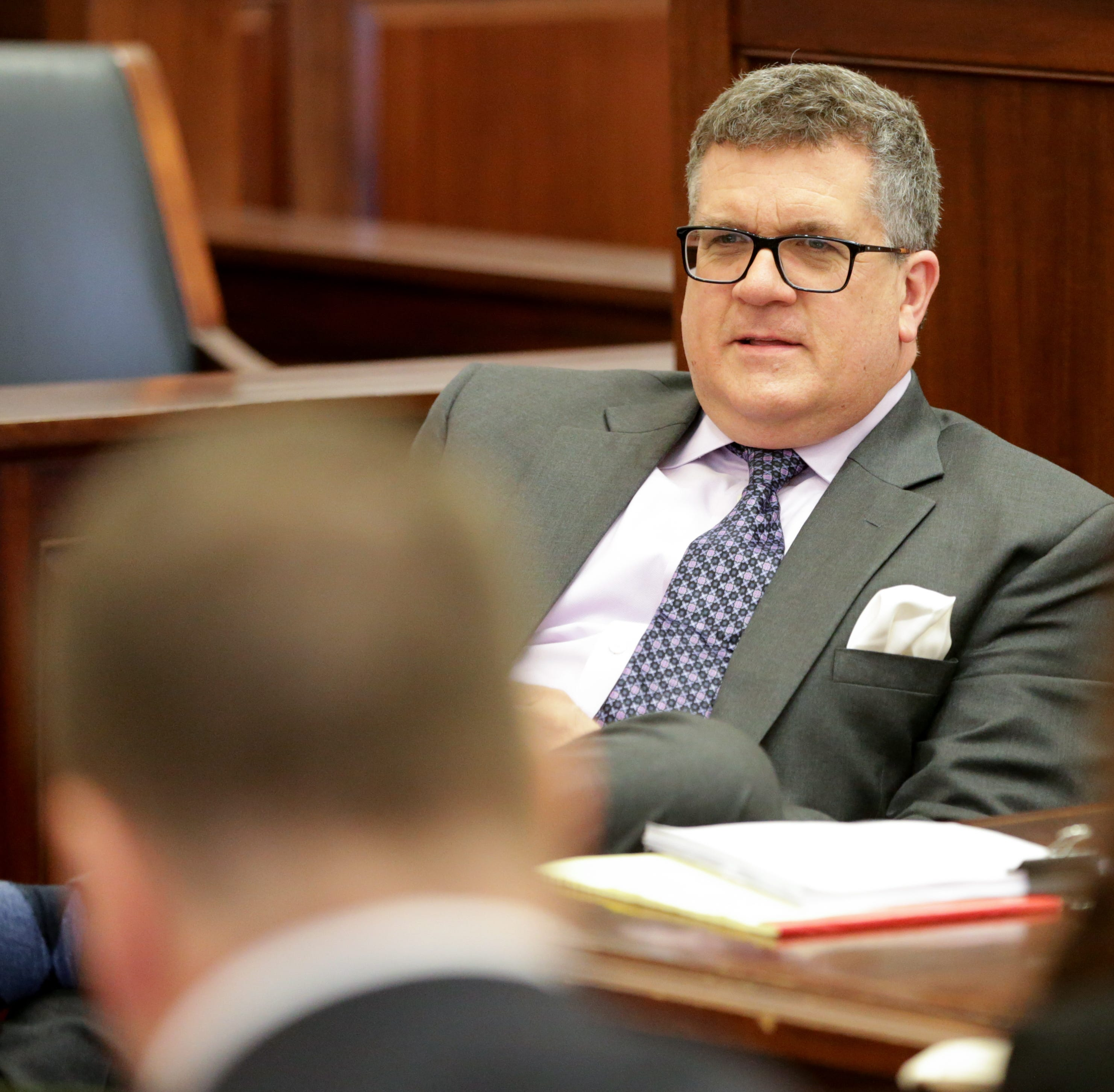 Christopher Finney, the owner of Finney Law Firm, sits during a hearing for a proposed settlement in the lawsuit involving secret texts and email, Thursday, March 7, 2019, in Judge Robert Ruehlman's courtroom in Cincinnati.