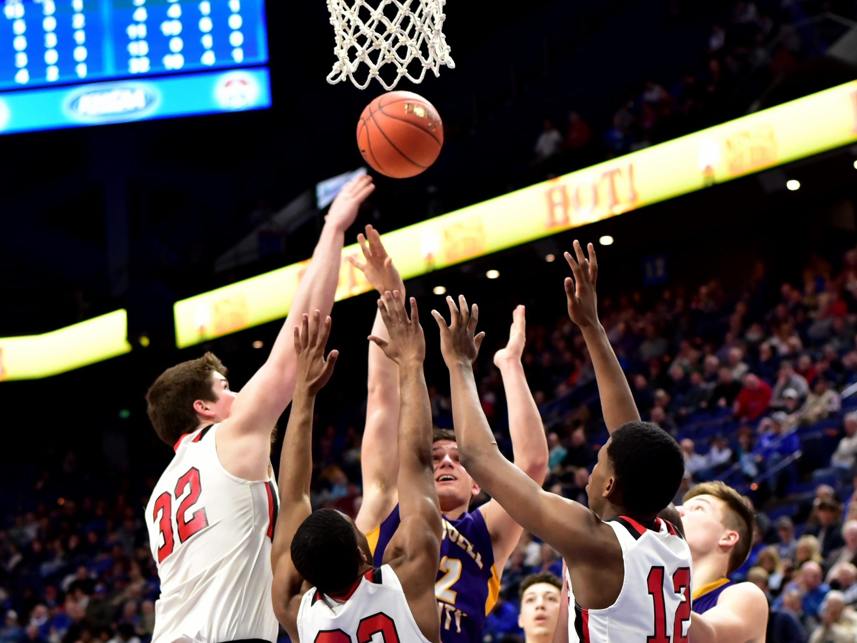 Campbell County's Tanner Lawrence (back) pushes up a short jump shot in the face of defensive traffic at the KHSAA Sweet 16 Tournament at Rupp Arena in Lexington, KY, March 6, 2019