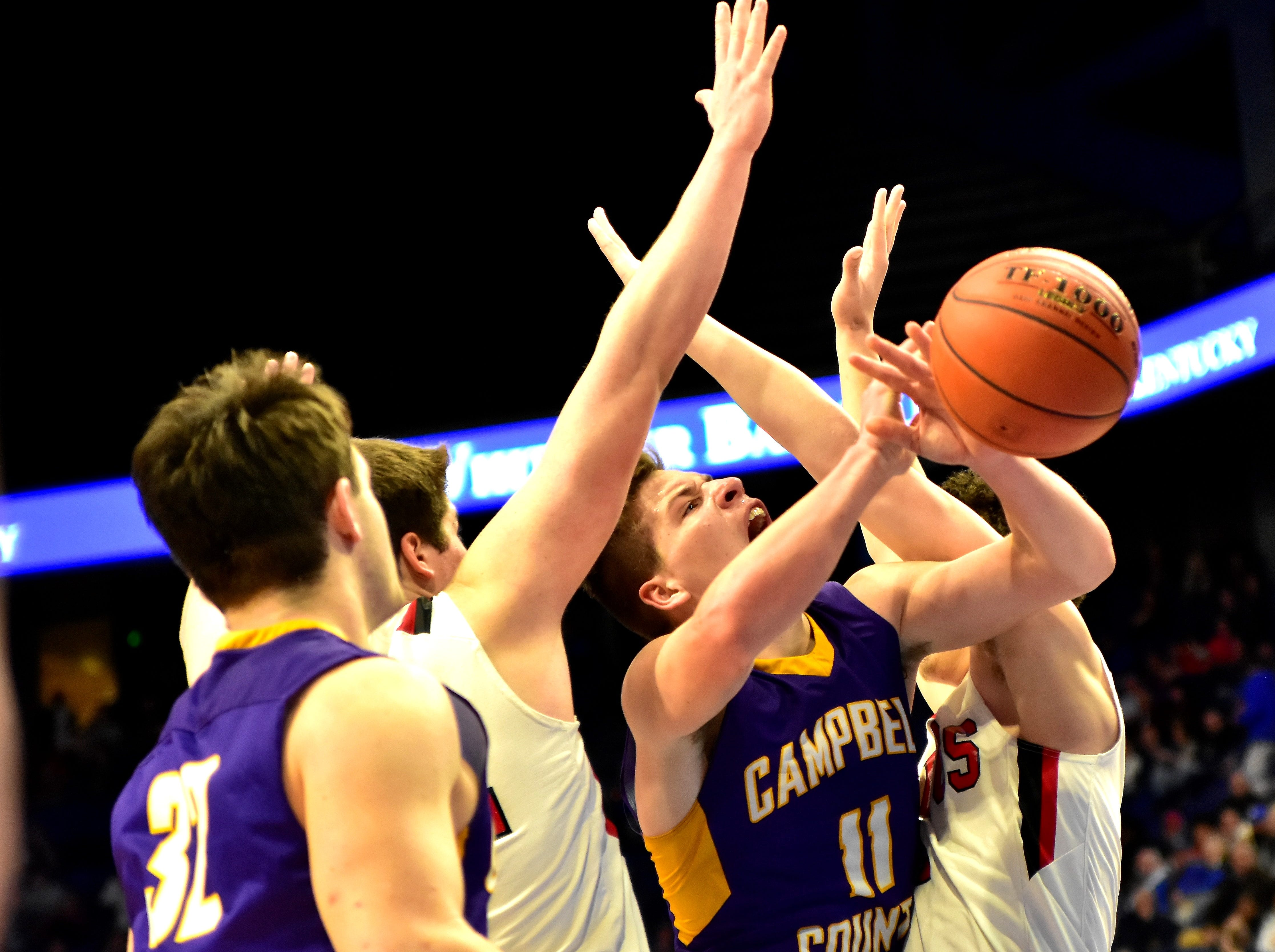 Reid Jolly is fouled on his way to the basket for Campbell County at the KHSAA Sweet 16 Tournament at Rupp Arena in Lexington, KY, March 6, 2019
