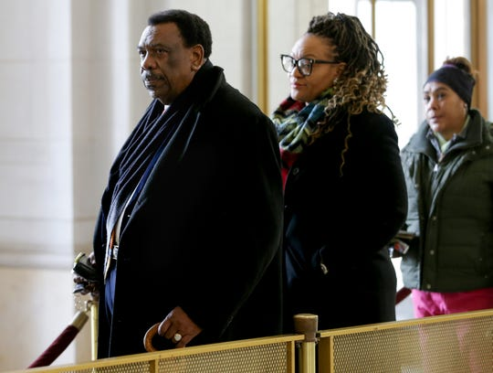 Cincinnati City Council member Wendell Young waits to pass through security ahead of a hearing for a proposed settlement in the lawsuit involving secret texts and email by members of Cincinnati City Council, Thursday, March 7, 2019, at the Hamilton County Courthouse in Cincinnati.