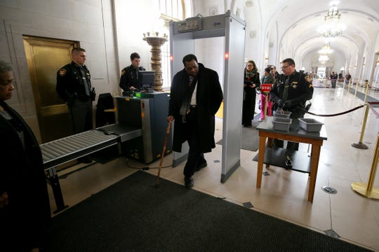 Cincinnati City Council member Wendell Young passes through security ahead of a hearing for a proposed settlement in the lawsuit involving secret texts and email by members of Cincinnati City Council, Thursday, March 7, 2019, at the Hamilton County Courthouse in Cincinnati.