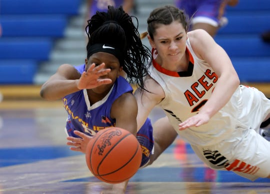 Purcell Marian guard Amil Ali-Shakir (5) battles Amanda Clearcreek forward Alyssa Evans for a loose ball during their regional semifinal Wednesday, March 6, 2019.