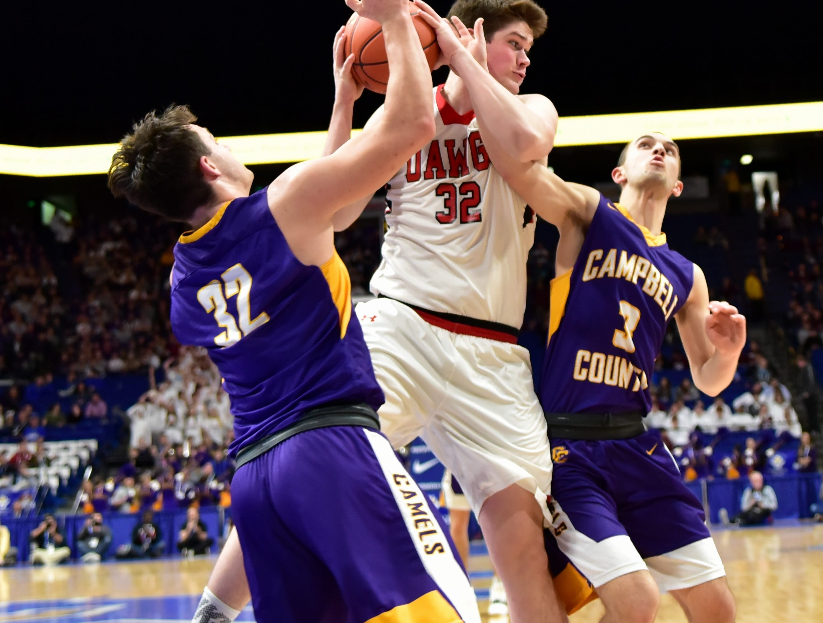 Campbell County's Tanner Lawrence and Noah Wirth press the John Hardin Dawgs hard as the Camels battle in first round action at the KHSAA Sweet 16 Tournament at Rupp Arena in Lexington, KY, March 6, 2019