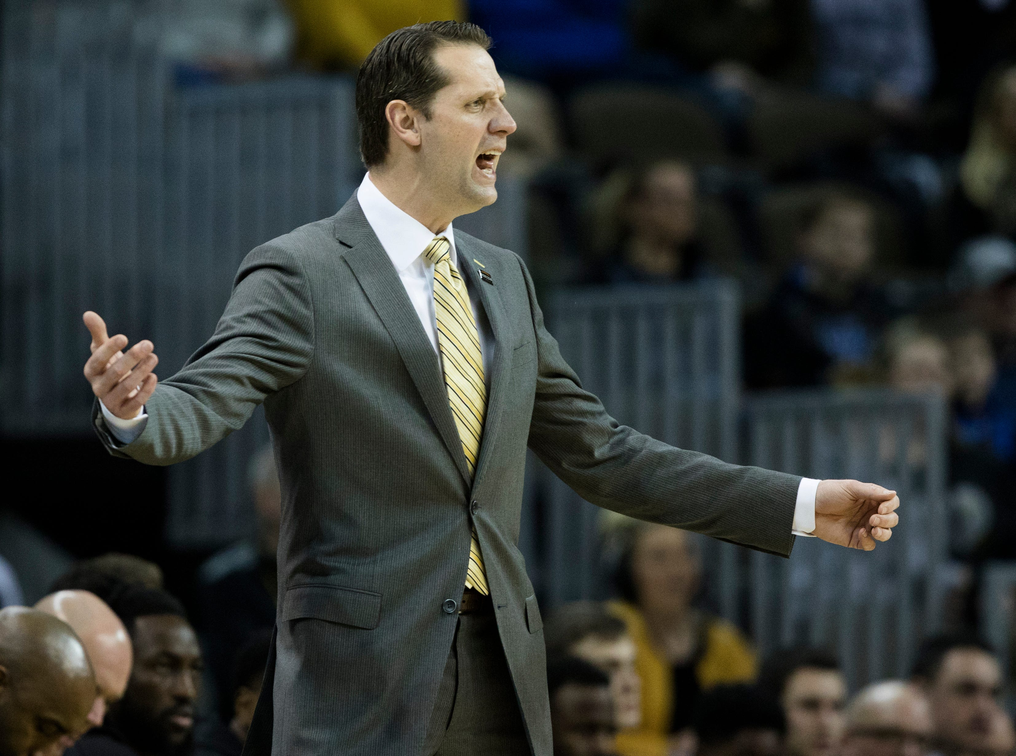 Northern Kentucky Norse head coach John Brannen yells at his players in the first half of the NCAA men's basketball game between Northern Kentucky Norse and Detroit Titans on Wednesday, March 6, 2019, at BB&T Arena in Highland Heights, Ky.