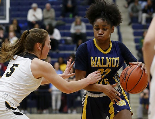 Walnut Hills guard Sean Kelly Darks is covered by Centerville guard Kenzie Smith during their Division I regional semifinal basketball game at Trent Arena in Kettering Wednesday, March 6, 2019.