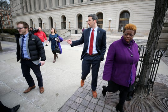 Cincinnati City council member P.G. Sittenfeld gestures toward Chris Seelbach (not pictured) outside of the Hamilton County Courthouse following a hearing for a proposed settlement in the lawsuit involving secret texts and email, Thursday, March 7, 2019, in Judge Robert Ruehlman's courtroom in Cincinnati.