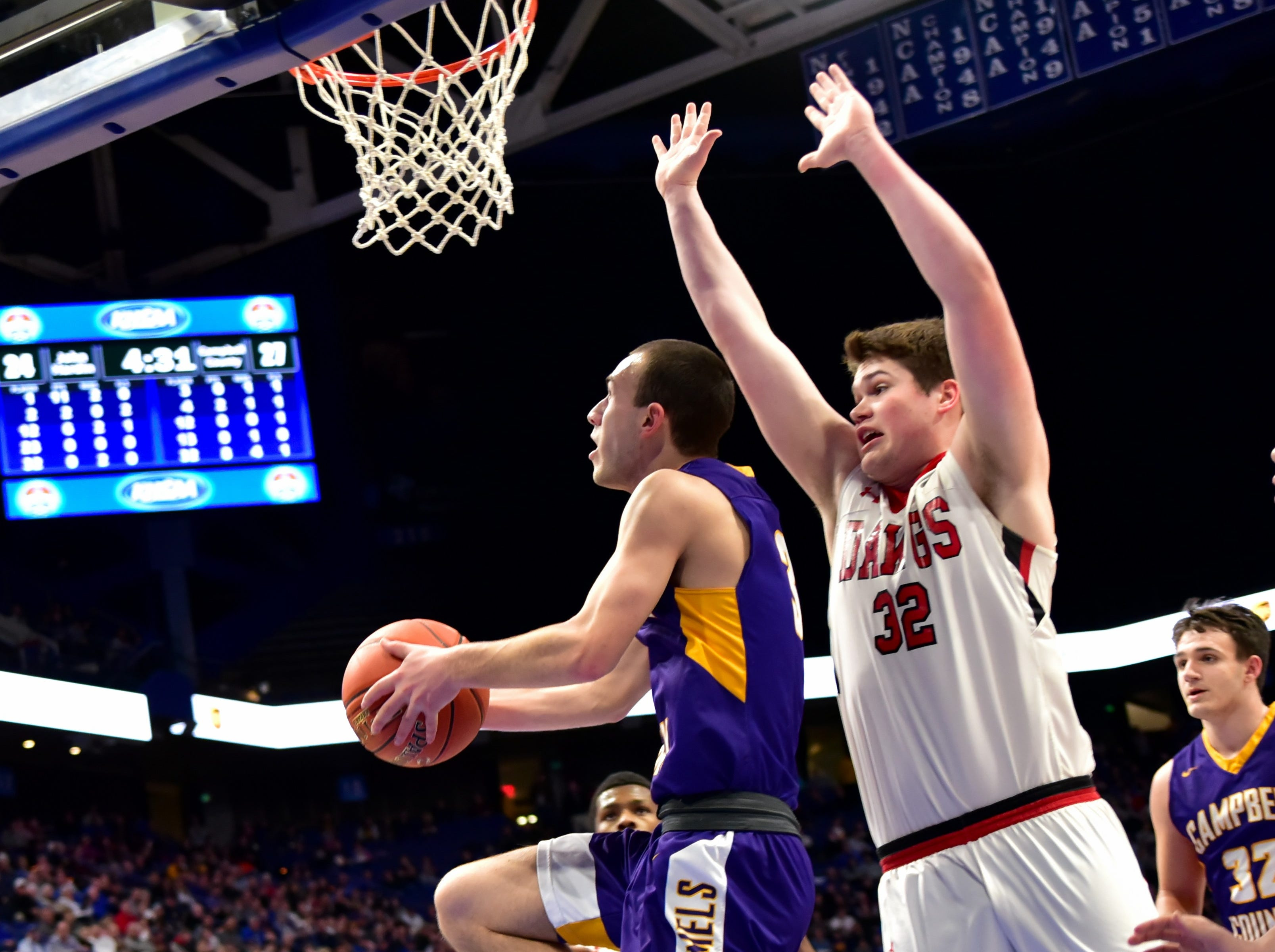 Noah Wirth (3) looks to drop in a back door layup for Campbell County at the KHSAA Sweet 16 Tournament at Rupp Arena in Lexington, KY, March 6, 2019