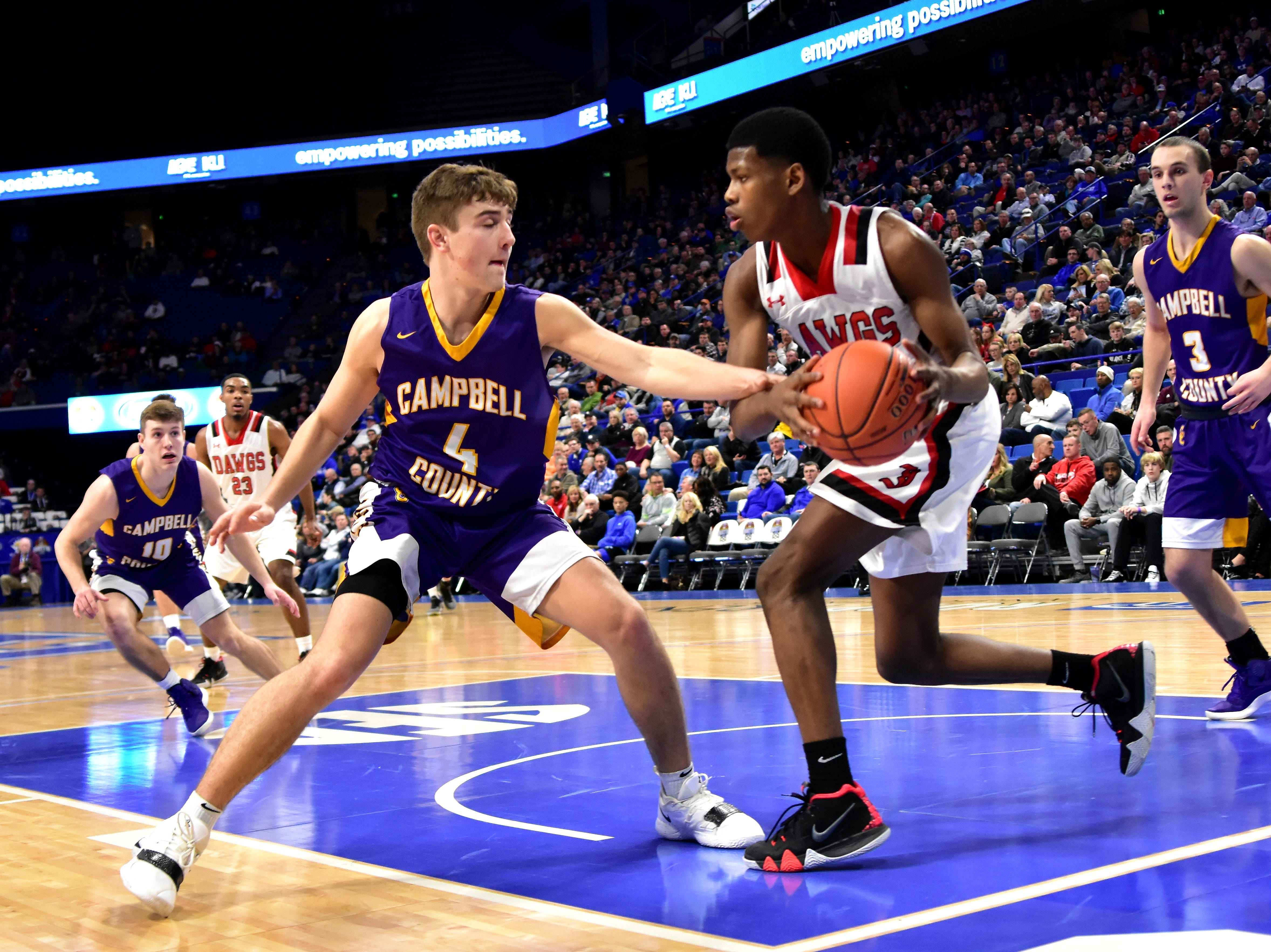 Drew Wilson (4) of Campbell County applies the full court press on John Hardin at the KHSAA Sweet 16 Tournament at Rupp Arena in Lexington, KY, March 6, 2019