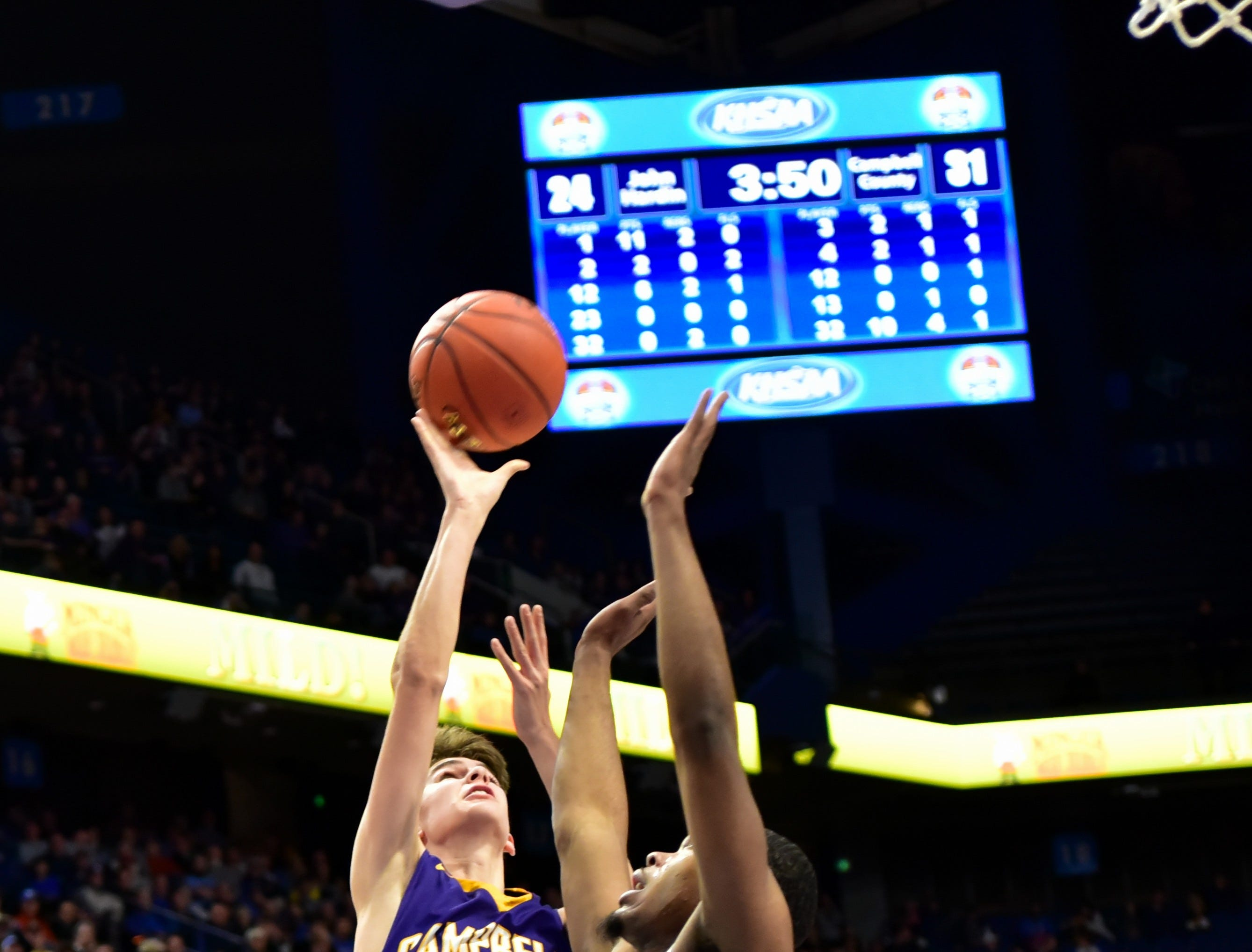 Jordan Gross (13) of Campbell County pushes up a short jump shot for a Camels basket at the KHSAA Sweet 16 Tournament at Rupp Arena in Lexington, KY, March 6, 2019