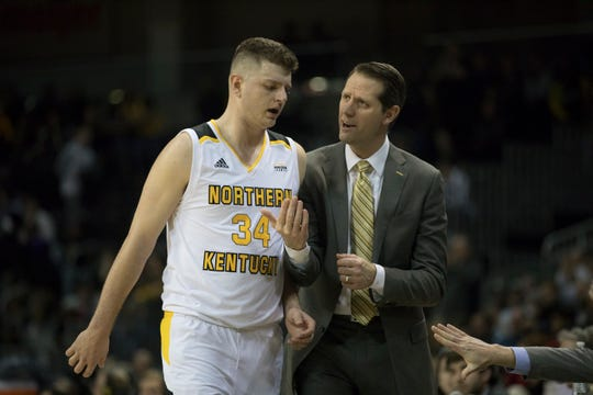 Northern Kentucky Norse head coach John Brannen talks to Northern Kentucky Norse forward Drew McDonald (34) in the second half of the NCAA men's basketball game between Northern Kentucky Norse and Detroit Titans on Wednesday, March 6, 2019, at BB&T Arena in Highland Heights, Ky.