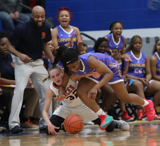 Purcell Marian guard Amil Ali-Shakir battles Alyssa Evans for a loose ball during their regional semifinal basketball game Wednesday, March 6, 2019.