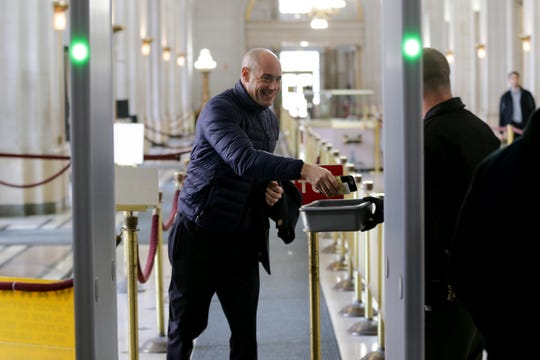 Cincinnati City Council member Greg Landsman passes through security ahead of a hearing for a proposed settlement in the lawsuit involving secret texts and email by members of Cincinnati City Council, Thursday, March 7, 2019, at the Hamilton County Courthouse in Cincinnati.