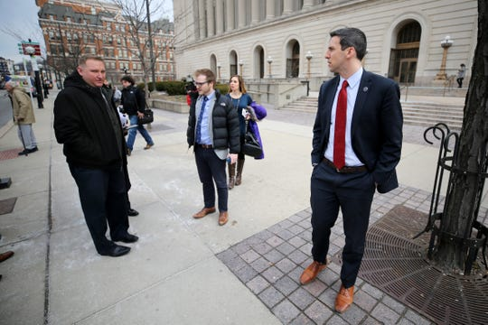 Cincinnati City council members Chris Seelbach, left, and P.G. Sittenfeld talk outside of the Hamilton County Courthouse following a hearing for a proposed settlement in the lawsuit involving secret texts and email, Thursday, March 7, 2019, in Judge Robert Ruehlman's courtroom in Cincinnati.