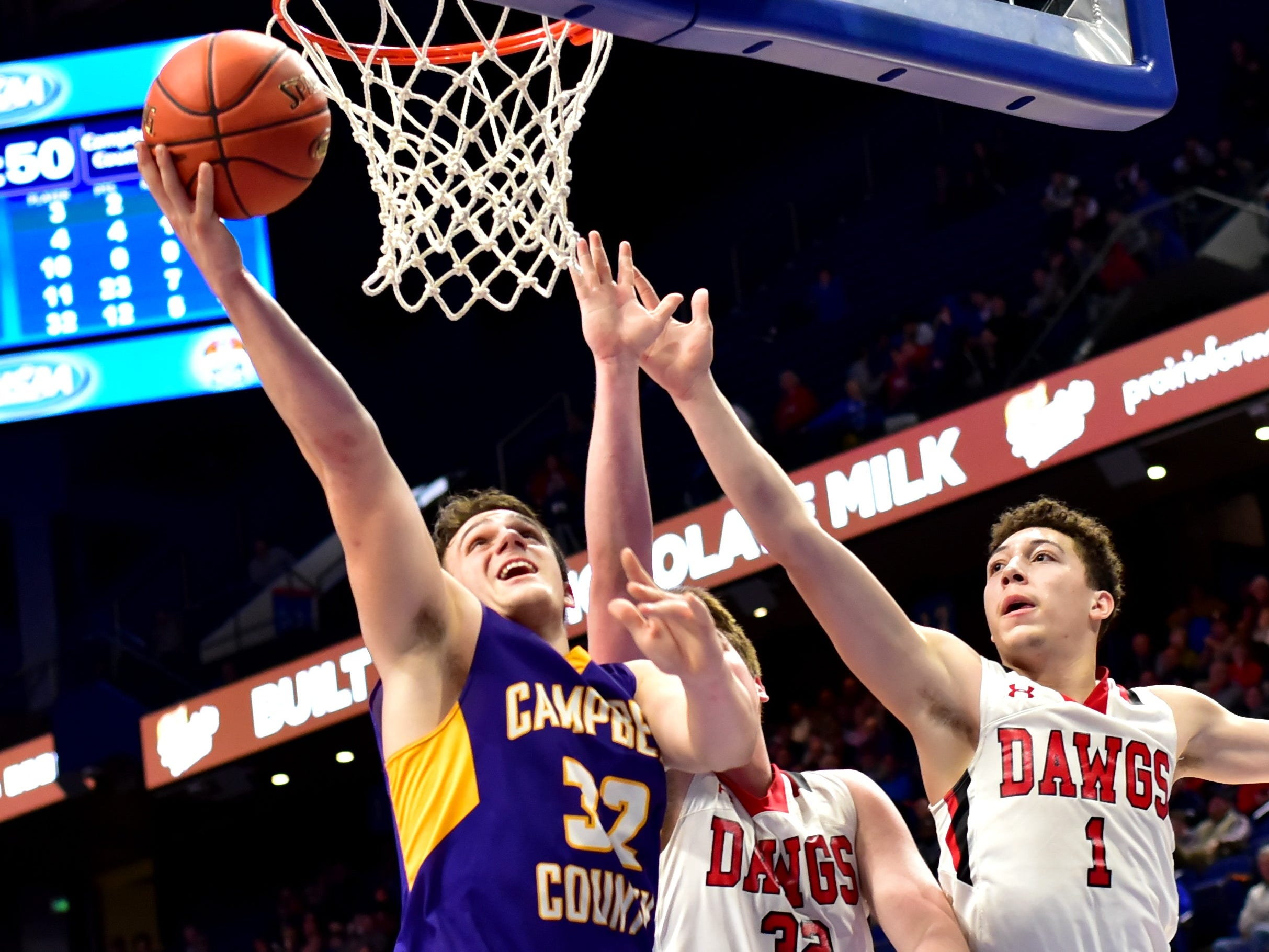 Tanner Lawrence (32) of Campbell County drops in a backdoor layup off of an offensive rebound for the Camels at the KHSAA Sweet 16 Tournament at Rupp Arena in Lexington, KY, March 6, 2019