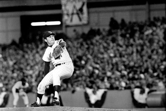 ** ADVANCE FOR WEEKEND EDITIONS, SEPT. 27-28 -- FILE -- ** In this Oct. 16, 1973 file photo, New York Mets pitcher Tom Seaver winds up during the first inning of game three of the World Series against the Oakland Athletics at Shea Stadium in New York.   (AP Photo/File)