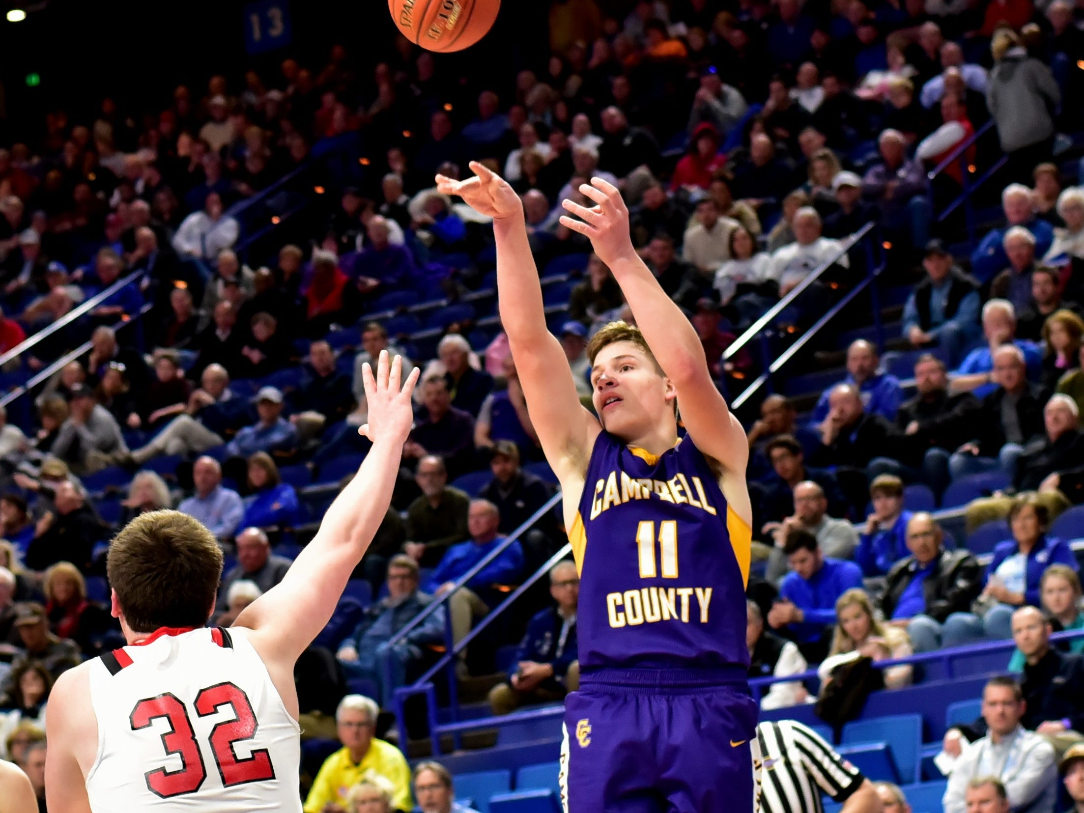 Reid Jolly lifts up a three point shot for Campbell County at the KHSAA Sweet 16 Tournament at Rupp Arena in Lexington, KY, March 6, 2019