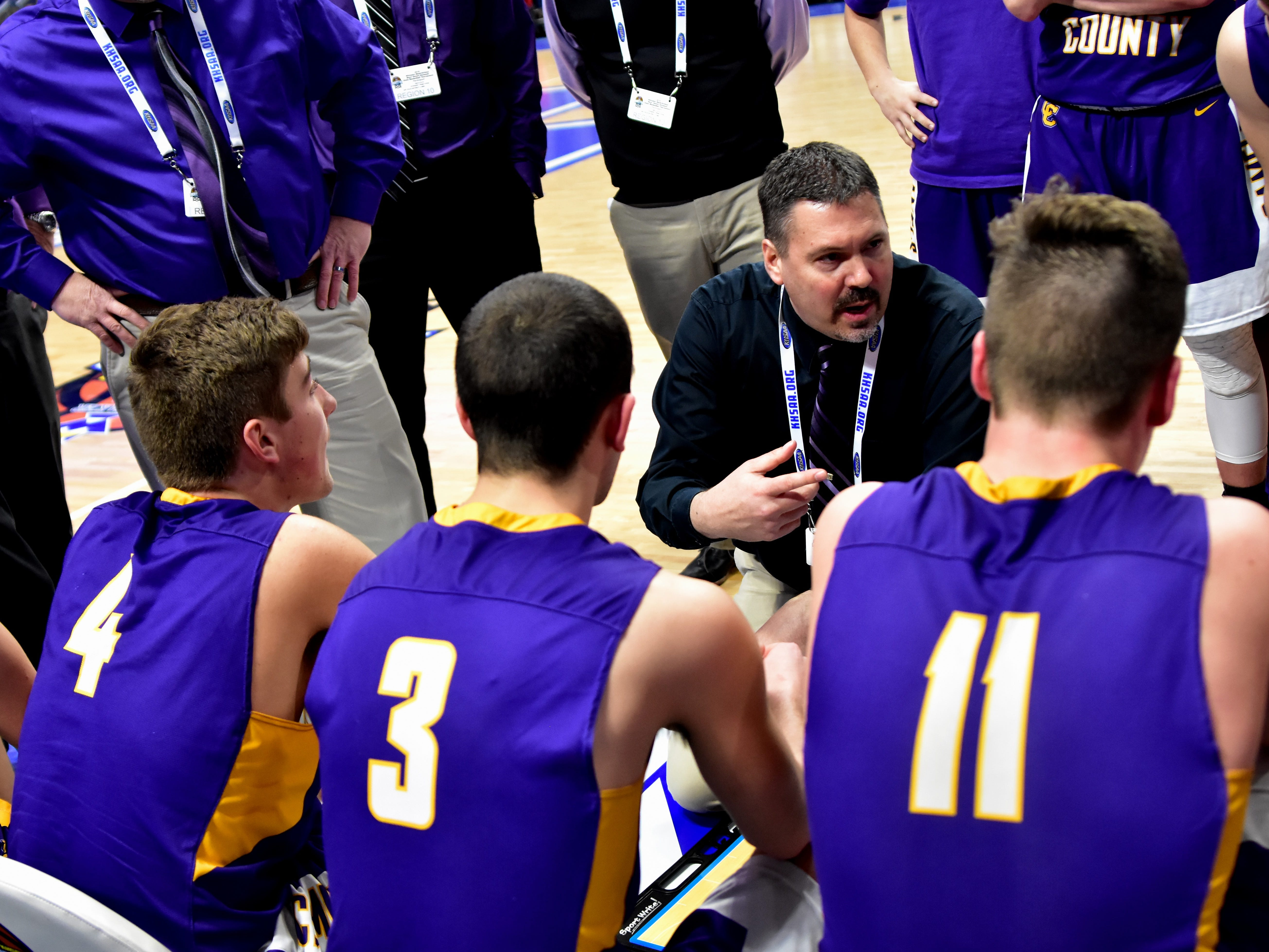 Coach Aric Russell goes over defensive strategy with his Campbell Coounty team during a time out at the KHSAA Sweet 16 Tournament at Rupp Arena in Lexington, KY, March 6, 2019