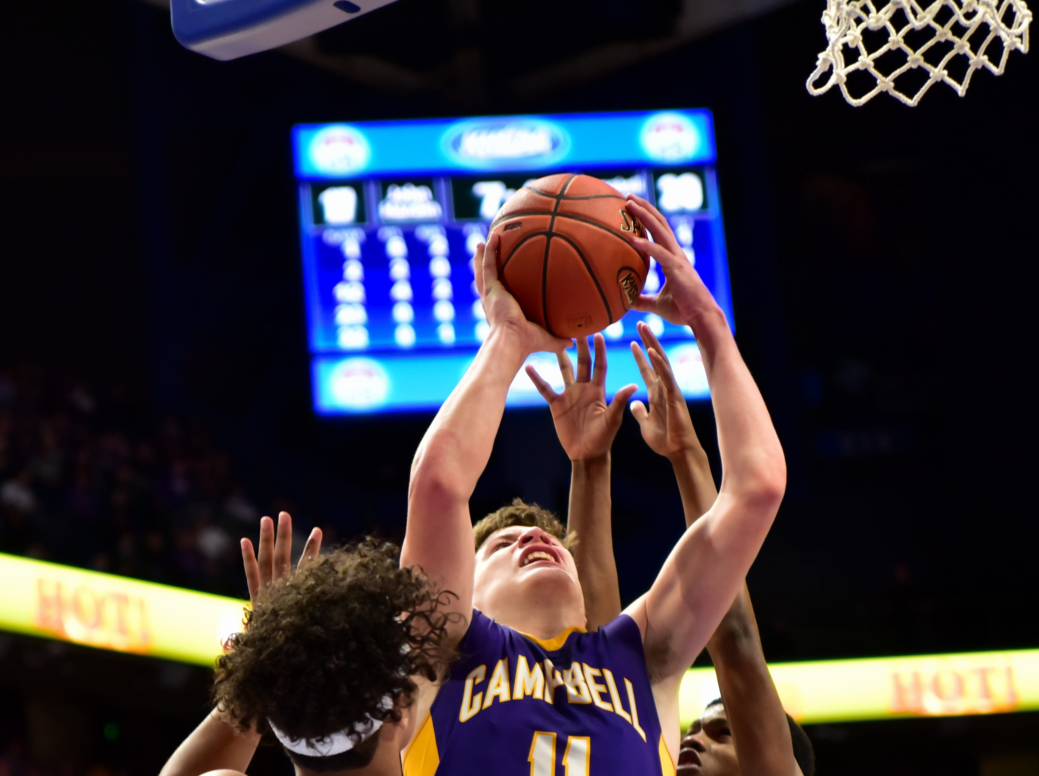 Reid Jolly of Campbell County plows through the lane and the John Hardin defense for a Camels score at the KHSAA Sweet 16 Tournament at Rupp Arena in Lexington, KY, March 6, 2019