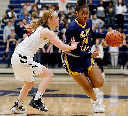 Walnut Hills forward Kennedi Myles is covered by Centerville guard Samantha Chable during their Division I regional semifinal basketball game at Trent Arena in Kettering Wednesday, March 6, 2019.