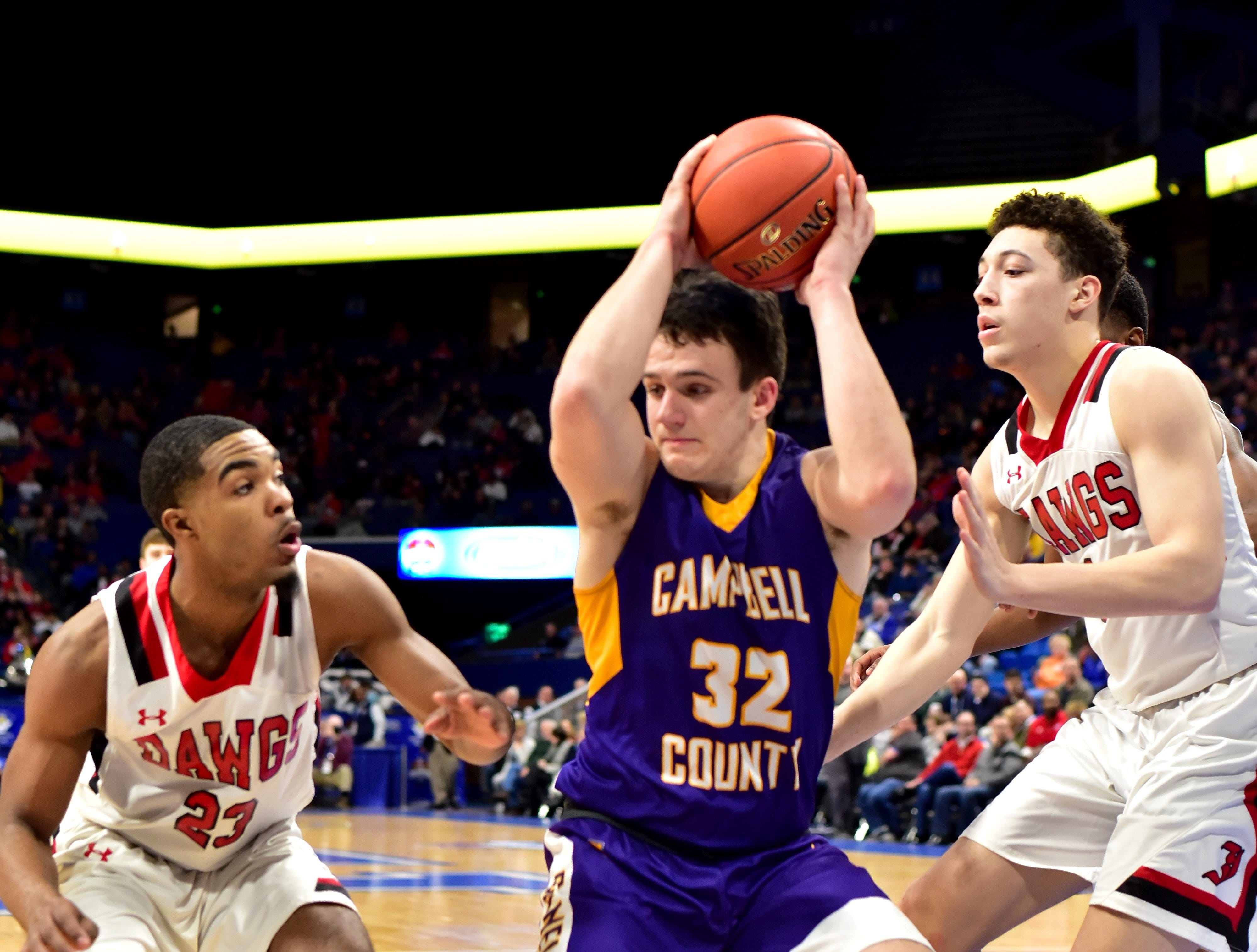 Tanner Lawrence (32) fights to maintain ball control for Campbell County at the KHSAA Sweet 16 Tournament at Rupp Arena in Lexington, KY, March 6, 2019